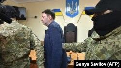 За повідомленням, це сталося біля суду в Херсоні, де розглядалася справа керівника «РИА Новости Украина» Кирила Вишинського (на фото), звинуваченого в державній зраді