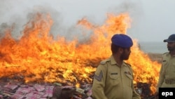 Piles of smuggled narcotics go up in flames during a drug-burning ceremony in Karachi, Pakistan.