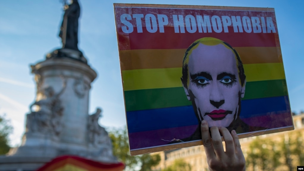 A demonstrator holders a placard depicting Russian President Vladimir Putin to denounce the reported detention, torture, and killing of gay men in Chechnya during a protest in Paris last month.