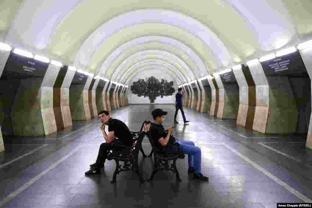 Men waiting in the subway. On May 2, Pashinian called off protests that had blocked roads across the country and some subway stations in Yerevan. On May 3, there were no closures reported.