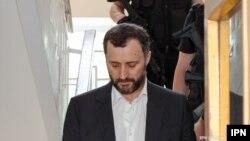 Fostul premier Vlad Filat escortat de poliție