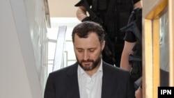 Vlad Filat, escortat de poliție