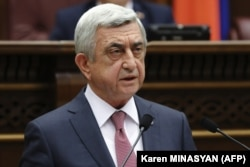 Serzh Sarkisian attends a session of parliament in Yerevan on April 17.