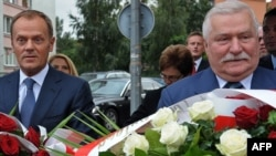 Former Polish President Lech Walesa (right) and Prime Minister Donald Tusk lay a wreath in Gdansk to mark the 30th anniversary of Solidarity on August 29.