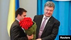 Președintele Petro Poroșenko, joi, la instalarea în funcție a noului ministru de externe al Ucrainei.