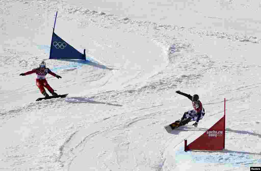 Switzerland's Nevin Galmarini (left) and Russia's Vic Wild compete during the men's snowboard parallel giant slalom finals. Wild won the gold medal. (Reuters/Dylan Martinez)