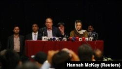 FILE: Former Pakistani Prime Minister Nawaz Sharif, appears with his daughter Maryam Nawaz, at a news conference in London, July 2018.