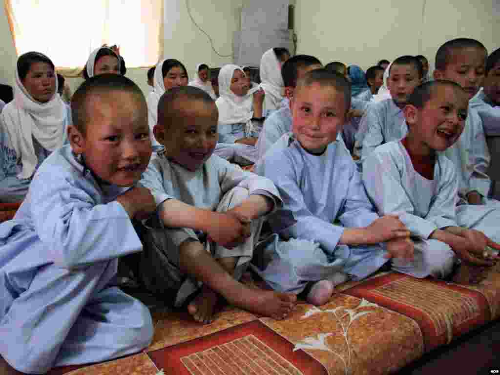 Afghan orphans prepare for lunch at an orphanage in Kabul on August 8. Despite the progress of the past few years, Afghanistan's economy remains in shambles and highly dependent on foreign aid, agriculture, and trade with neighboring countries. Photo by S. Sabawoon for epa