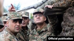 Armenia - Defense Minister Seyran Ohanian (R) inspects Armenian army positions on the border with Azerbaijan, 9Aug2013.