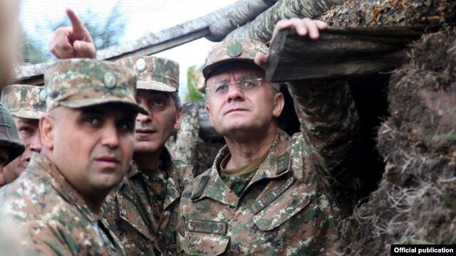 Armenia - Defense Minister Seyran Ohanian (R) inspects Armenian army positions on the border with Azerbaijan, 9Aug2013.