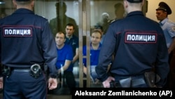 Ukrainian sailors who were captured and taken into Russian custody attend a court hearing in Moscow on May 27.