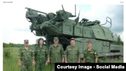 RUSSIA-Russian officers with BUK missile launcher from bellingcat investigation