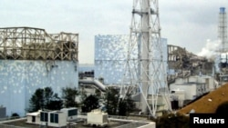 A March 15 photograph of Reactors No. 1, 2, 3 and 4 at the Fukushima Daiichi Nuclear Power Plant (handout)