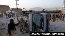 Pakistani security officials inspect a Police truck after a bomb blast in restive Quetta on April 24.