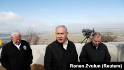 Israeli Prime Minister Benjamin Netanyahu, U.S. Republican Senator Lindsey Graham and U.S. Ambassador to Israel David Friedman visit the border line between Israel and Syria at the Israeli-occupied Golan Heights, March 11, 2019