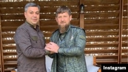 Russia -- Chechen leader Ramzan Kadyrov (R) and Armenia's National Security Service Director Artur Vanetsian pose for a photograph in Chechnya in 2019.