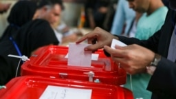 صحنهای از رأیگیری در انتخابات ریاست جمهوری در اردیبهشت ۹۶