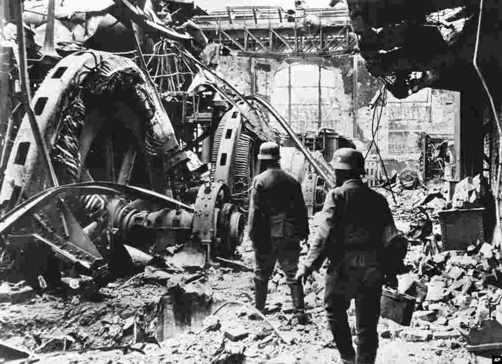 German troops passing through a wrecked generating station in the factory district of Stalingrad on December 28, 1942, where fierce fighting had been raging for months. (AP)