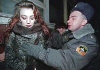 A policeman arrests a prostitute in Russia in 2001