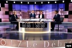 Теледебаты кандидатов в президенты Франции Марин Ле Пен и Эммануэля Макрона, май 2017. Ле Пен, которую поддерживал Кремль, потерпела сокрушительное поражение