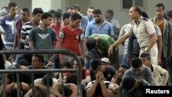 Preživeli migranti nakon brodoloma