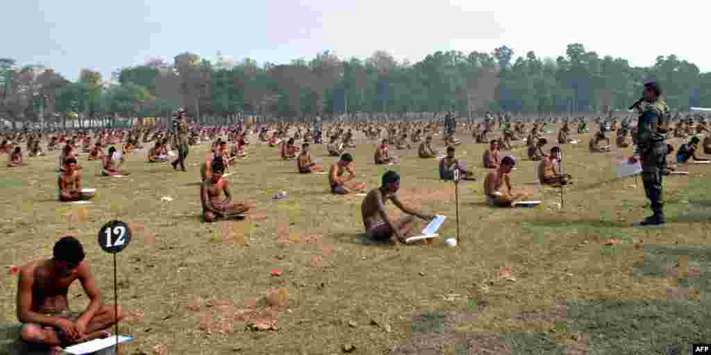 Indian Army candidates sit in their underwear to deter cheating as they take a written exam during a recruitment day in Muzaffarpur. (AFP)