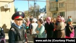 Kazakh police have sealed off and evacuated apartment blocks in the town of Kulsary.