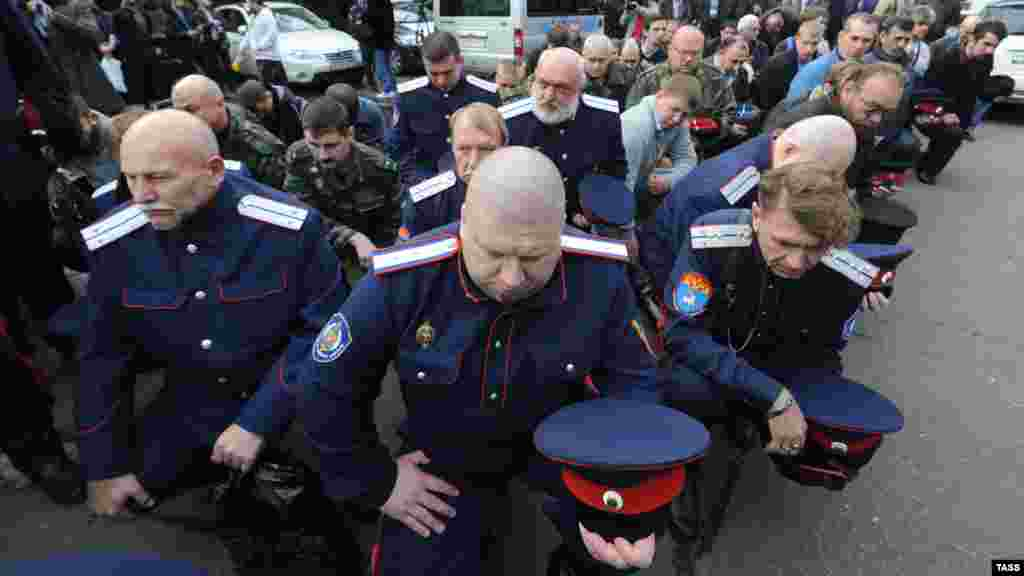 Cossacks block the entrance of the Winzavod art gallery in Moscow on October 2 to protest an exhibition of works inspired by activist punk performance group Pussy Riot. (ITAR-TASS)