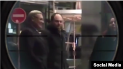 The Instagram post shows former Prime Minister Mikhail Kasyanov and antigovernment activist Vladimir Kara-Murza entering a Strasbourg building and was filtered to appear as if the men are being viewed through the scope of a rifle.