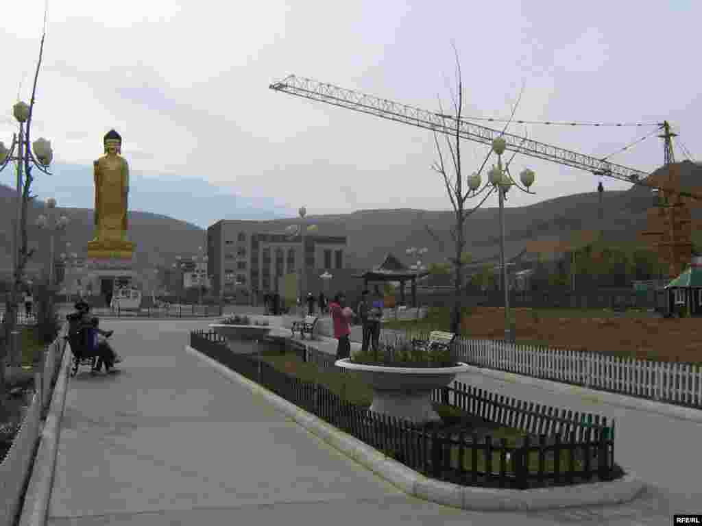 A newly built, 23-meter-high Golden Buddha gleams in a park on the southern tip of Ulan Bator. - Mongolia has sought to resurrect its Buddhist heritage following years of communist repression.