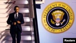 Президент США Барак Обама прибывает в аэропорт Брюсселя. 25 марта 2014 года.
