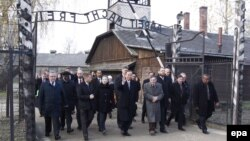 UN Secretary-General Ban Ki-moon (center) and his wife on a visit to the former German Nazi Concentration Camp KL-Auschwitz I, in Oswiecim, on November 18