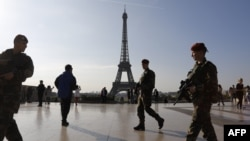 French soldiers patrol in front of the Eiffel Tower in Paris during the first round of the country's presidential election on April 23.