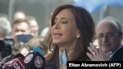 Former Argentinian President Cristina Fernandez de Kirchner speaks to reporters in Buenos Aires in October.