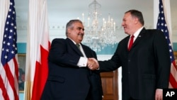 Secretary of State Mike Pompeo, right, shakes hands with Bahrain Foreign Minister Khalid bin Ahmed Al Khalifa, Wednesday, July 17, 2019, during their meeting at the State Department in Washington. (AP Photo/Jacquelyn Martin)