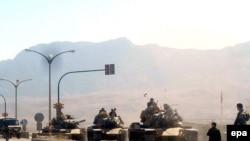 Reports say Turkish tanks are headed toward a Kurdish militant camp inside Iraq.
