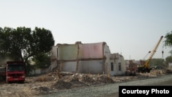 Uzbekistan - half demolished house in the center of the city of Urgench, Khorazm region,