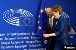 Scotland's First Minister Nicola Sturgeon is welcomed by European Parliament President Martin Schulz ahead of a meeting in Brussels on June 29.