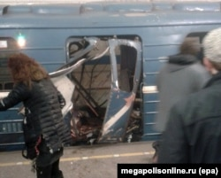 Images showed a door blown off and carnage inside the train car.