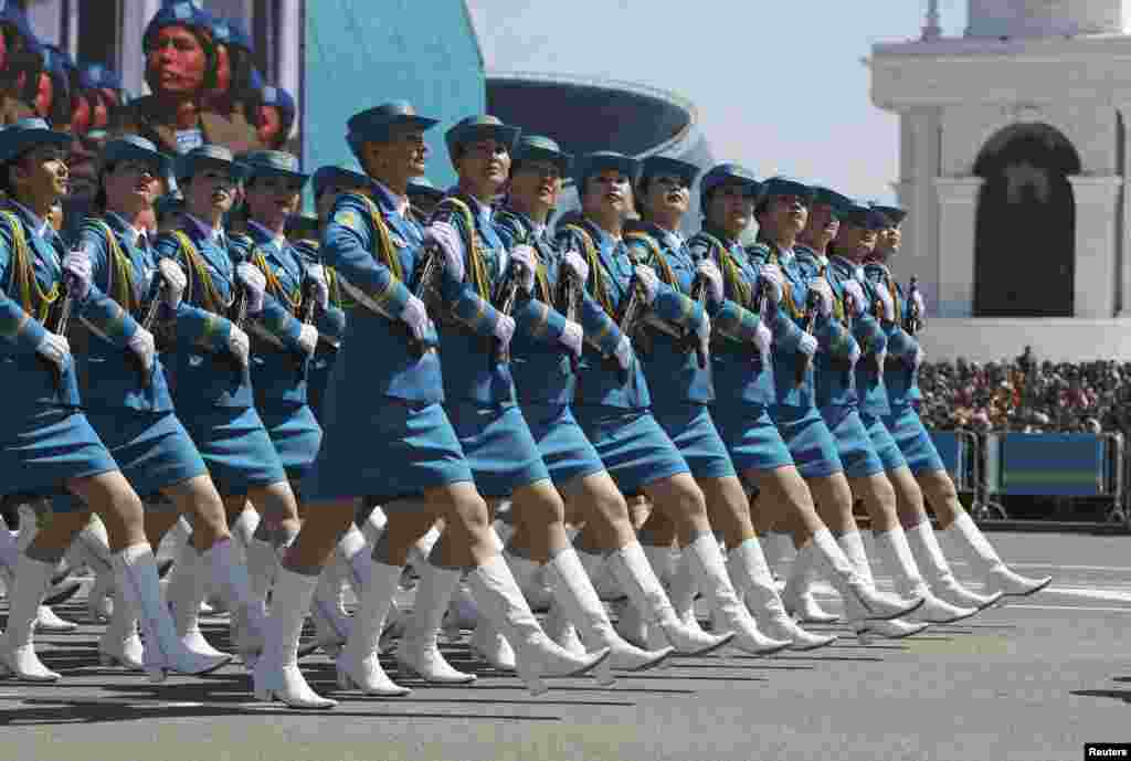 Female troops march during a parade of Kazakhstan's armed forces to mark the Defender of the Fatherland Day in Astana on May 7. (Reuters/Mukhtar Kholdorbekov)