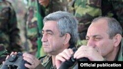 Armenian President Serzh Sarkisian (left) watches military exercises in Nagorno-Karabakh on October 22.