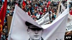 Portreti i Sylejman Selimit gjatë një proteste në Prishtinë, në mbrojtje të tij nga akuzat për krime lufte.