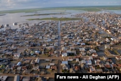 An image shows flooded streets in the northern Iranian village of Agh Ghaleh on March 23.