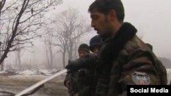 Командир поддерживаемых Россией сепаратистов Михаил Толстых, известный под псевдонимом Гиви (на переднем плане).