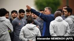 Iran's Portuguese soccer coach, Carlos Queiroz, gestures as he talks to his team.