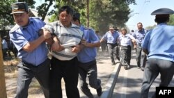 Police detain opposition supporters during rally in central Bishkek.
