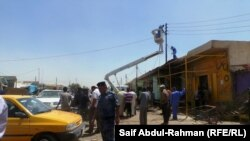 На месте взрыва в городе Кут, 16 июня 2013 г.