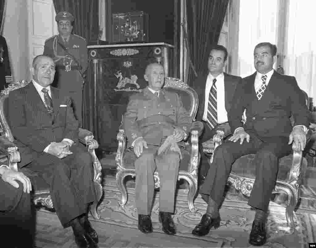 Saddam Hussein (right) as Iraqi vice president meeting Spanish dictator Francisco Franco (center) on December 10, 1974.  During his climb to power, Hussein was invited as the guest of Spanish President Carlos Arias Navarro (left) at the Royal Palace of El Pardo in Madrid.