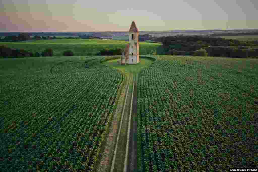 Cornfields surround the ancient Somogyvamos steppe church, near Lake Balaton. The lonely ruins are the only remains of a village that was reportedly wiped out by Ottoman Turks during a war that raged in the region in the Middle Ages.
