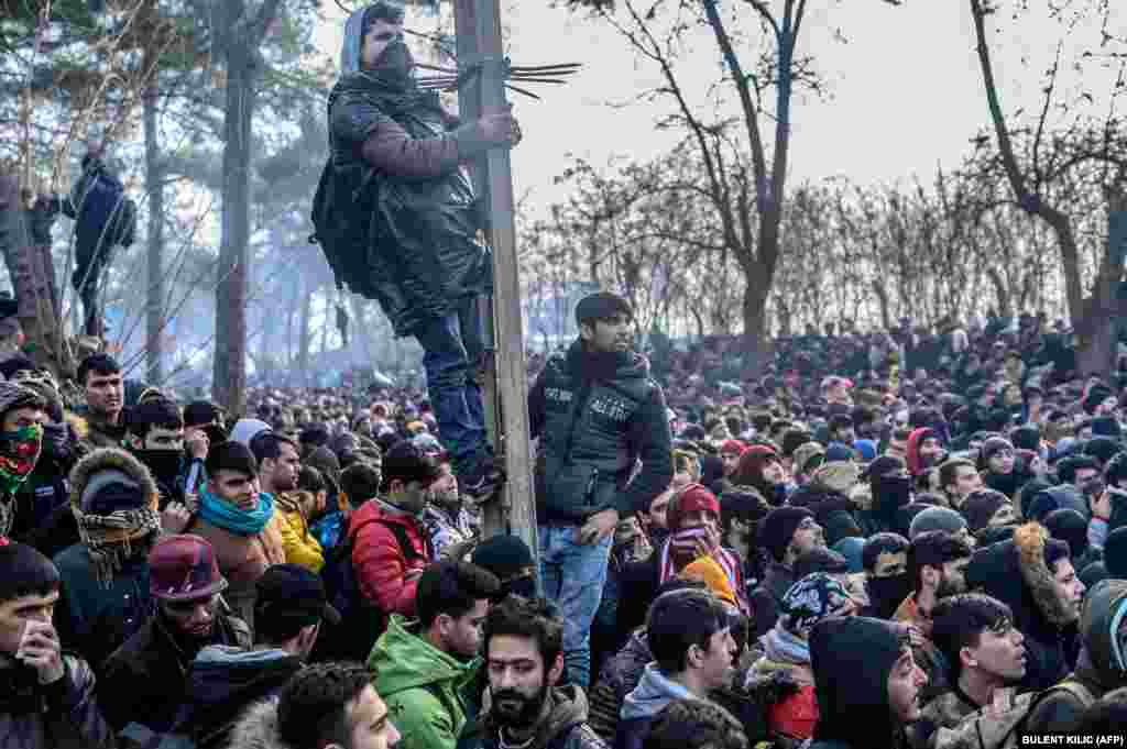 Migrants gather inside the buffer zone of the Turkey-Greece border, at Pazarkule, in the Edirne district, on February 29.